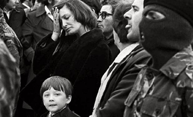 Bobby Sands' son Robert Gerald holds his mother's hand at the funeral of his father Bobby in west Belfast flanked by Masked IRA men. Picture by Martin Wright
