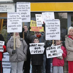 Protesters from the Lone Parents Campaign picket Minister for Children Frances Fitzgerald's constituency office in Dublin