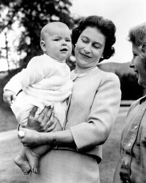 File photo dated 08/11/1960 of Queen Elizabeth holding Prince Andrew during an outing in the grounds at Balmoral, Scotland, where the Royal Family are on holiday. PRESS ASSOCIATION Photo.