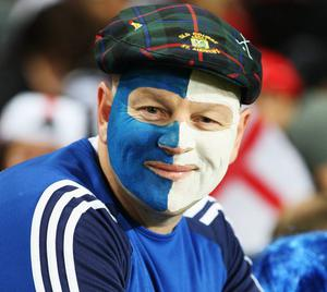 AUCKLAND, NEW ZEALAND - OCTOBER 01: A Scotland fan smiles prior to the IRB 2011 Rugby World Cup Pool B match between England and Scotland at Eden Park on October 1, 2011 in Auckland, New Zealand.  (Photo by Sandra Mu/Getty Images)