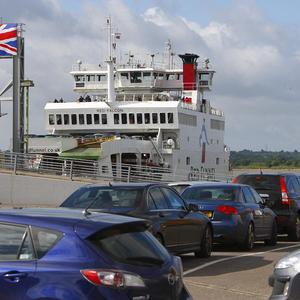 Cars wait to board a ferry in Southampton as weather and large numbers of festivalgoers caused chaos on the Isle of Wight