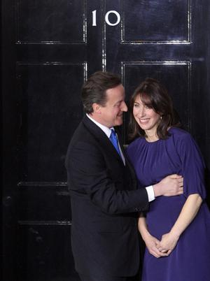 Britain's new Prime Minister David Cameron and his wife, Samantha, on the doorstep of 10 Downing Street after an audience with The Queen at which she invited him to form a new government