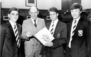 At wine and cheese party held at Campbell College, Belfast, to launch their souvenir brochure which publicises the school's forthcoming rugby tour to Vancouver, Canada (from left), Jonathan Park, vice-Captain, 1st XV, Mr Jack Ferris Master, in charge of rugby, Brian Browne, captain 1st XV and Tim Dudgeon, Head Boy. This team will be playing six matches on the tour which starts on March 19, 1988.