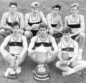 Members of the Campbell College team, winners of the all-Ireland senior schools athletics cup at Bellfield, Dublin. Front, from left, are Gavin Browne with the Ulster schools senior athletics cup, Brian Browne (captain) with the all Ireland trophy, and Peter Colville, with the Ulster schools senior relay cup. Back, Philip Calvert, Neil McClements, John Gibney and Neil Palmer. Not available for the picture was Justin Reid, 1988.