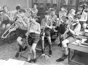 The young musicans of Cabin Hill Prep. School, Upper Newtownards Road, have an impromptu rehearsal before the annual school concert, 1972.
