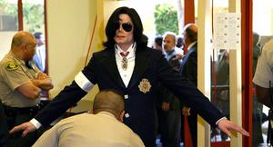 Michael Jackson is searched as he enters the courthouse for his arraignment on child molestation charges, 16 January 2004 at the courthouse in Santa Maria, California.