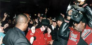 "Michael Jackson arrives at the HMV store in London,England during his to ""BAD"" tour of Britain on the 14th of July 1988.While performing in London, England Michael breaks a world record (as shown in the Guinness Book Of World Records) with 504,000 people attending 7 sold out shows at Wembley Stadium, more than any other artist."
