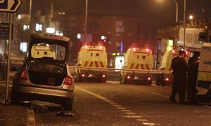The scene on the Upper Newtownards Road beside Alliance Party east Belfast MP Naomi Long's office where a PSNI patrol car (left) was petrol bomb reportedly with officers sitting inside