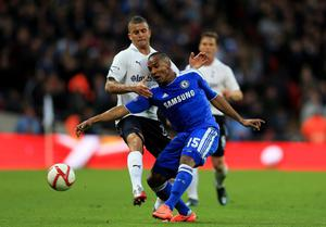 LONDON, ENGLAND - APRIL 15:  Florent Malouda of Chelsea is tackled by Kyle Walker of Spurs during the FA Cup with Budweiser Semi Final match between Tottenham Hotspur and Chelsea at Wembley Stadium on April 15, 2012 in London, England.  (Photo by Clive Rose/Getty Images)