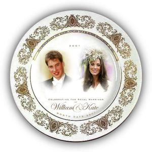 """UNDATED - UNITED KINGDOM: In this handout photograph provided by Woolworths, a souvenir plate is seen to mark the anticipated engagement of Prince William and his girlfriend Kate Middleton. Beneath the portraits of Prince William and Kate Middleton is the message ?Celebrating the Royal marriage of William and Kate,"""" with a space left for the date. The leading high street store has designed a range of memorabilia including traditional china plates, thimbles, mouse mats and Will and Kate shaped pick and mix sweets in anticipation of the event. (Photo by Woolworths via Getty Images)"""