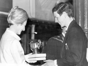 C.I.J.H Drummund receives the Dufferin Medal (Classics) from Lady Huddie (wife of Sir David Huddie, Managing Director of the Aero Engine Division of Rolls-Royce Ltd) during the distribution of prizes on Speech Day at Campbell College, Belfast, 1969.