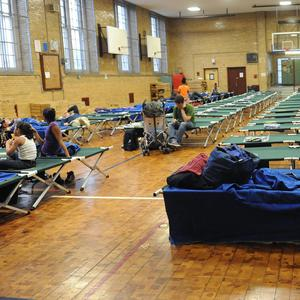 A public shelter in Manhattan's lower east side begins to fill up ahead of the storm's arrival (AP)