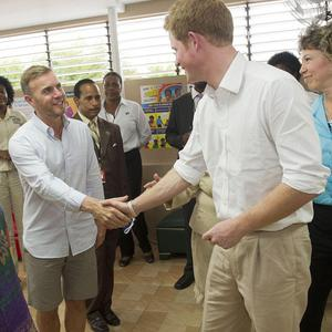 Prince Harry meets Gary Barlow during his visit to Jamaica as part of his Diamond Jubilee tour