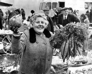 """""""I've got a lovely bunch of carrots"""", Dora Povey, Bangor market, October 1974,  To purchase this photograph as large format canvas or acrylic visit Belfast Telegraph page on www.niphotocanvas.co.uk"""