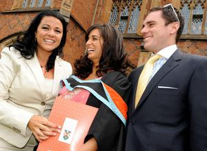Nicole Sayee celebrates with her fiance Neal McCortter and sister Natasha Sayee after graduating in medicine at Queen's University in Belfast today.