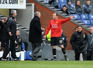 File photo dated 19/04/2008 of Alex Ferguson and  Wayne Rooney (right) on the touchline