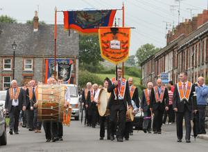 Bessbrook District Lodges parade through the strreets of Bessbrook before heading to Co Armagh 12th celebration in Killylea. 12 July 2011