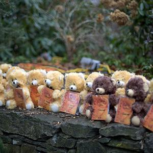 Teddy bears, each representing a victim of the Sandy Hook Elementary School shooting, sit on a wall at a memorial in Newtown (AP)