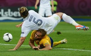 KIEV, UKRAINE - JUNE 19:  Philippe Mexes of France falls on Olof Mellberg of Sweden during the UEFA EURO 2012 group D match between Sweden and France at The Olympic Stadium on June 19, 2012 in Kiev, Ukraine.  (Photo by Lars Baron/Getty Images)