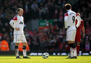 LIVERPOOL, ENGLAND - MARCH 06:  Dimitar Berbatov and Wayne Rooney of Manchester United prepare to kick off after conceding a goal during the Barclays Premier League match between Liverpool and Manchester United at Anfield on March 6, 2011 in Liverpool, England.  (Photo by Alex Livesey/Getty Images)
