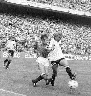 Norman Whiteside showing some of his fighting spirit as he tackles back in defence against Austrian Gernot Jurtin.