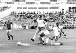 Norman Whiteside and Billy Hamilton put pressure on Yugoslavian defender Ivan Gudelj as he makes a back pass to his goalkeeper during Northern Ireland's first game in the World Cup, which ended in a scoreless draw.