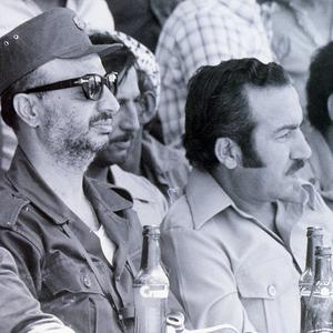 Palestinian leader Yasser Arafat, left, with his deputy Abu Jihad, right, who was killed by Israeli commandos in Tunisia in 1988 (AP/Palestinian Authority)
