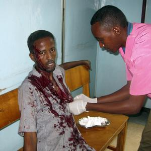 A nurse treats a wounded civilian in Medina hospital, Mogadishu, Somalia