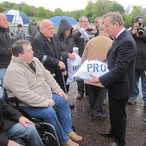 Paul Gallagher hands over a sack of signatures on a petition to Ulster Unionist MLA Danny Kinahan