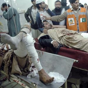 Injured victims of a suicide bombing are treated at a local hospital in Peshawar (AP)