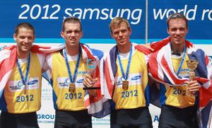 MUNICH, GERMANY - JUNE 17:  (L-R) Chris Bartley, Richard Chambers, Rob Williams and Peter Chambers of Great Britain win 2012 World Cup winners trophy of the Lightweight Men`s four during the 2012 Samsung World Rowing Cup III at the Ruderregattastrecke on June 17, 2012 in Munich, Germany.  (Photo by Alexander Hassenstein/Bongarts/Getty Images)