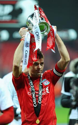 LONDON, ENGLAND - FEBRUARY 26:  Steven Gerrard of Liverpool celebrates with the trophy after victory in the Carling Cup Final match between Liverpool and Cardiff City at Wembley Stadium on February 26, 2012 in London, England. Liverpool won 3-2 on penalties.  (Photo by Mike Hewitt/Getty Images)