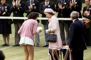 01/07/1977 Queen Elizabeth II talking to Britain's Virginia Wade after presenting her with the trophy as Women's Singles Champion. Wade beat Betty Stove of the Netherlands 4-6 6-3 6-1. PRESS ASSOCIATION Photo.