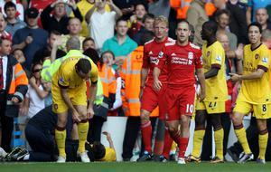 Joe Cole of Liverpool leaves the pitch after being sent off during the Barclays Premier League match between Liverpool and Arsenal at Anfield on August 15, 2010