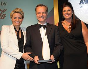 Belfast Telegraph editor Mike Gilson receives the award for Newspaper of the Year from Marie Campbell (left) of sponsors Coca-Cola and Gillian Shields, CIPR chair