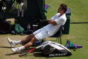 Tomas Berdych of Czech Republic celebrates match point during his Quarter Final match against Roger Federer of Switzerland on Day Nine of the Wimbledon Lawn Tennis Championshi