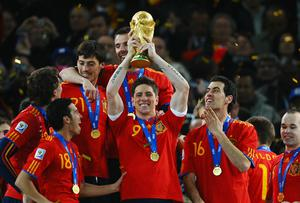 Fernando Torres of Spain lifts the World Cup trophy as the Spain team celebrate victory following the 2010 FIFA World Cup South Africa Final match between Netherlands and Spain at Soccer City Stadium on July 11, 2010 in Johannesburg, South Africa