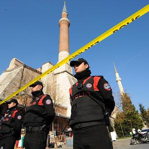 Police stand guard outside Turkey's Topkapi palace after a gunman ran amok inside (AP)