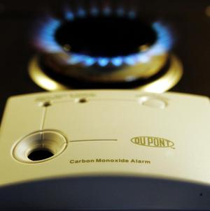 The wife of a man killed by carbon monoxide poisoning at his home died in hospital