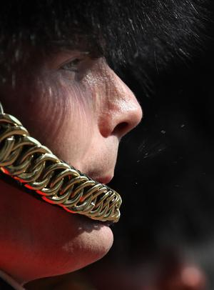 LONDON, ENGLAND - APRIL 20:  A member of the Scots Guards exhales in an attempt to cool himself during the Changing of the Guard ceremony at Buckingham Palace on April 20, 2011 in London, England. Soldiers guard Queen Elizabeth II and other royals at Buckingham Palace in a 24 hour rotation with a ceremonial hand over at 11.30 in the morning.  (Photo by Peter Macdiarmid - WPA Pool/Getty Images)