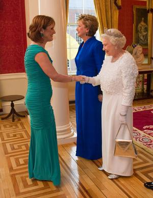 Queen Elizabeth II (R) greets Iris Robinson, the wife of Northern Ireland First Minister Peter Robinson with Irish President Mary McAleese (C) at the State Banquet in Dublin Castle on May 18, 2011 i