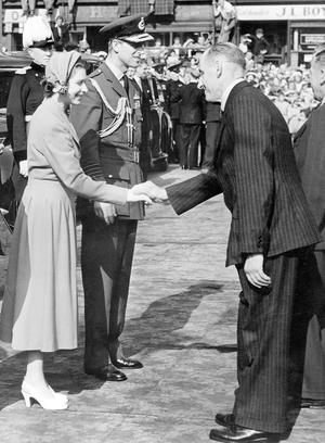 The Queen, Elizabeth 11. 1953. Coronation Year visit.Councillor George Moore is presented to the Queen and the Duke at Lisburn during the 1953 Royal visit.  1/7/1953