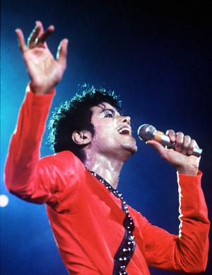 Singer Michael Jackson performs on stage in 1987 in Japan.