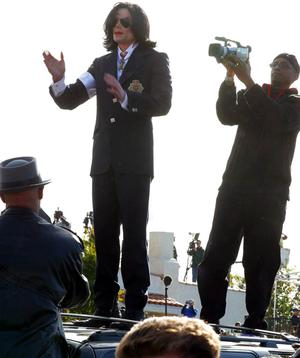 Following his arraignment, Michael Jackson delighted fan by jumping on top of his car and greeting his supporters at the Santa Maria Courthouse in Santa Maria, CA on January 16, 2004.