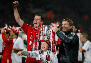 LONDON, ENGLAND - FEBRUARY 26:  Kenny Dalglish manager of Liverpool and Jamie Carragher celebrate with the trophy  after the Carling Cup Final match between Liverpool and Cardiff City at Wembley Stadium on February 26, 2012 in London, England. Liverpool won 3-2 on penalties.  (Photo by Paul Gilham/Getty Images)