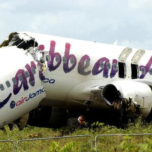 The broken fuselage of a Caribbean Airlines Boeing 737-800 is seen after it crashed at the end of the runway in Guyana (AP)