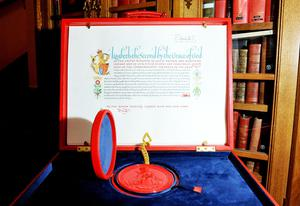 """LONDON - APRIL 21: The 'Instrument of Consent', which is the Queen's historic formal consent to Prince William's forthcoming marriage to Catherine Middleton, is displayed at the Crown Office at the House of Lords on April 21, 2011 in London, England. Under the Great Seal of the Realm, Queen Elizabeth signed an elaborate notice of approval which proclaimed, in transcribed calligraphy, consent to the union of """"Our Most Dearly Beloved Grandson Prince William Arthur Philip Louis of Wales, K.G. and Our Trusty and Well-beloved Catherine Elizabeth Middleton"""".  (Photo by Clive Gee/WPA Pool/Getty Images)"""