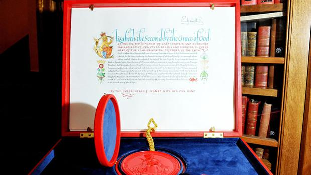 "LONDON - APRIL 21: The 'Instrument of Consent', which is the Queen's historic formal consent to Prince William's forthcoming marriage to Catherine Middleton, is displayed at the Crown Office at the House of Lords on April 21, 2011 in London, England. Under the Great Seal of the Realm, Queen Elizabeth signed an elaborate notice of approval which proclaimed, in transcribed calligraphy, consent to the union of ""Our Most Dearly Beloved Grandson Prince William Arthur Philip Louis of Wales, K.G. and Our Trusty and Well-beloved Catherine Elizabeth Middleton"".  (Photo by Clive Gee/WPA Pool/Getty Images)"