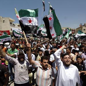 Syrians hold a protest on the outskirts of Idlib, Syria (AP)