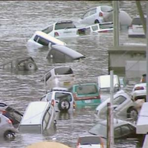 In this image fromJapan's NHK TV video footage, vehicles are washed away by tsunami in coastal area in eastern Japan after Japan was struck by a magnitude 8.9 earthquake off its northeastern coast Friday, March 11, 2011.